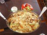 Фото готового блюда: Баклажан с картошкой в духовке