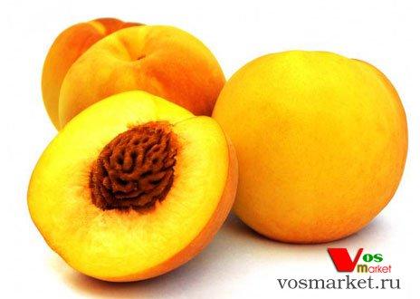 Плод персика - половинка с косточкой