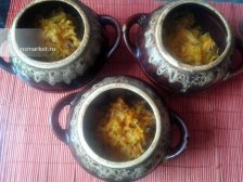 Фото к пятому шагу приуготовлению рецепта Гречка в горшочке с сосисками