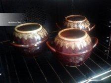 Фото к седмому шагу приуготовлению рецепта Гречка в горшочке с сосисками
